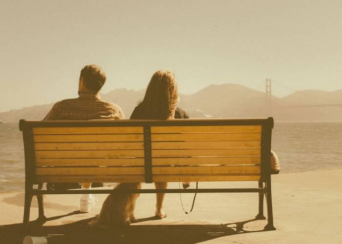 couple on bench near sea